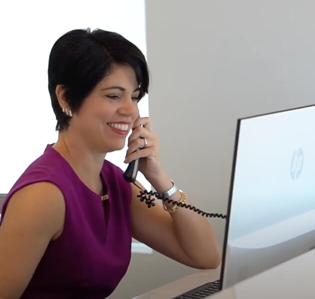 smiling woman talking on phone